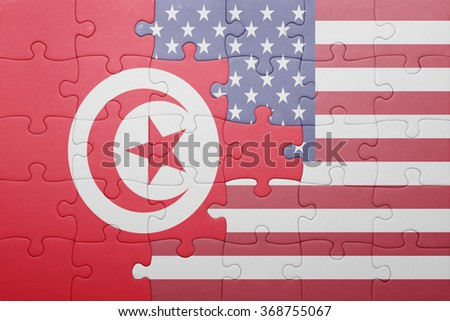 puzzle with the national flag of united states of america and  tunisia.concept - stock photo