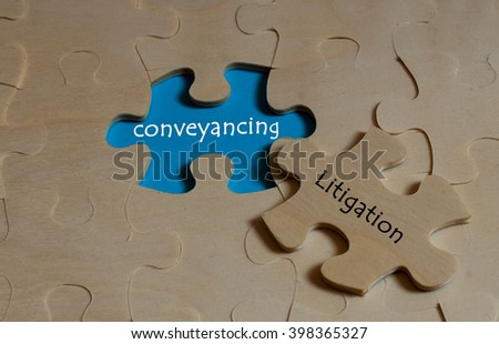 puzzle with word conveyancing and litigation - stock photo
