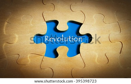 Puzzle with word revolution - stock photo