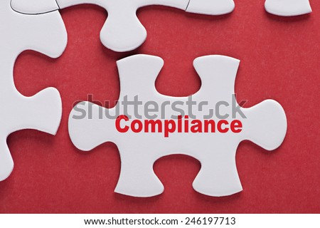 Puzzle written word Compliance - stock photo