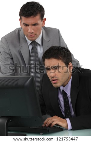 Puzzled businessmen with a laptop - stock photo