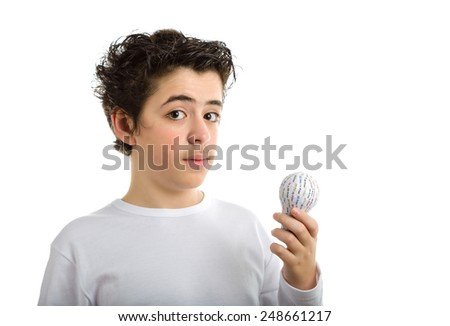 Puzzled Caucasian smooth-skinned boy in white long sleeved t-shirt holding 3D printed lightbulb - stock photo