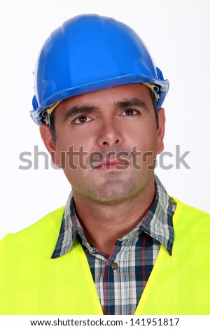 Puzzled construction worker - stock photo