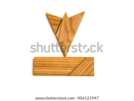Puzzled wooden arrow pointed down on white background - stock photo