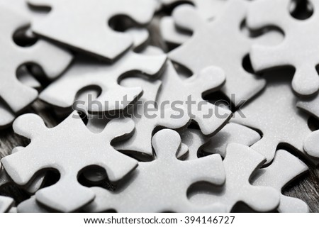 Puzzles on wooden table, closeup - stock photo