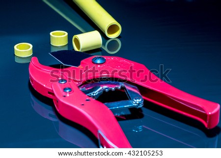 Pvc pipe cutter on back - stock photo