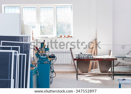 PVC windows and doors manufacturing, factory tools, window frame profile, production equipment - stock photo