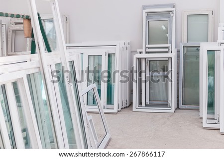PVC windows and doors manufacturing, window frame profile, production equipment - stock photo