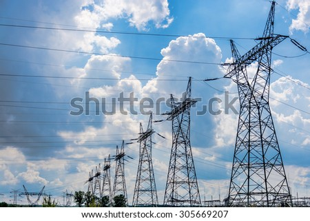 Pylon and transmission power line in summer day - stock photo