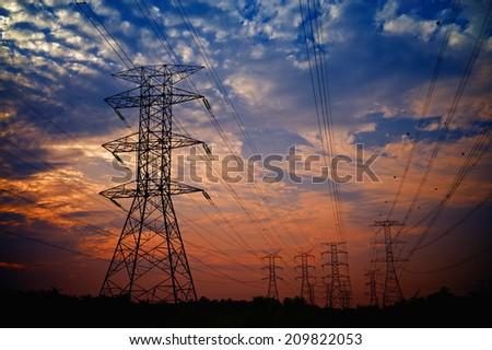 Pylon high voltage power line on sunset  - stock photo