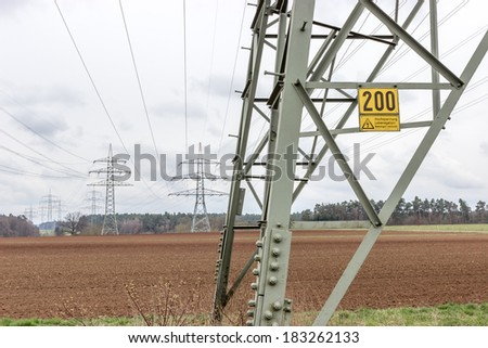 Pylons of a power line. - stock photo