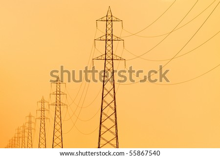 pylons supporting overhead electricity conductors for electric power transmission - stock photo
