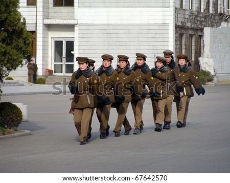 PYONGYANG - MARCH 23: North Korean war woman squad in preparation for military parade on March 23, 2010 in Pyongyang, North Korea - stock photo
