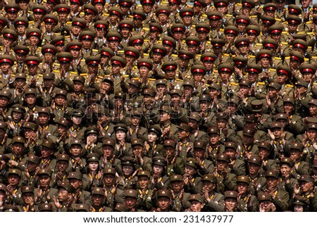 PYONGYANG, NORTH KOREA - CIRCA APRIL 2012: North Korea army officers cheers for Kim Jong-Un at the military parade celebrate centenary birth of President Kim Il Sung. - stock photo