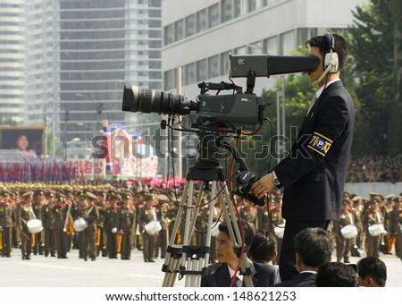 PYONGYANG, NORTH KOREA - CIRCA JULY 2013: North Korea cameramen at the military parade celebrating the 60th anniversary of the conclusion of the Korean War. Pyongyang, North Korea. Circa July 2013 - stock photo