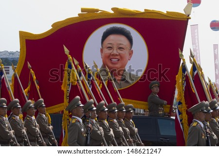 PYONGYANG, NORTH KOREA - CIRCA JULY 2013 : North Korean soldiers at the military parade in Pyongyang with the portrait of Kim Jonhg-Il of the 60th anniversary of the conclusion of the Korean War. Pyongyang, North Korea. Circa July 2013 - stock photo