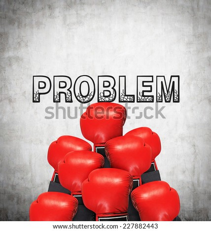 Pyramid made of boxing gloves. Problem solving concept.  - stock photo