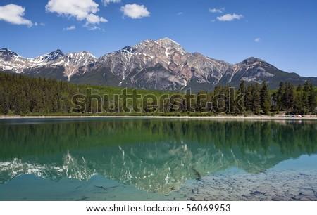 Pyramid Mountain reflected in Patricia Lake.  Located in Jasper National Park, Alberta, Canada. - stock photo