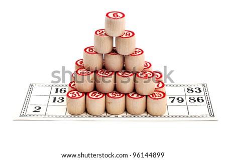 Pyramid of bingo kegs on bingo card isolate on white - stock photo