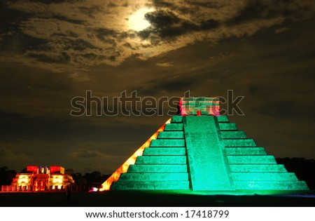Pyramid of  Kukulkan, Chichen Itza, shot under the full moon during a special light show. - stock photo