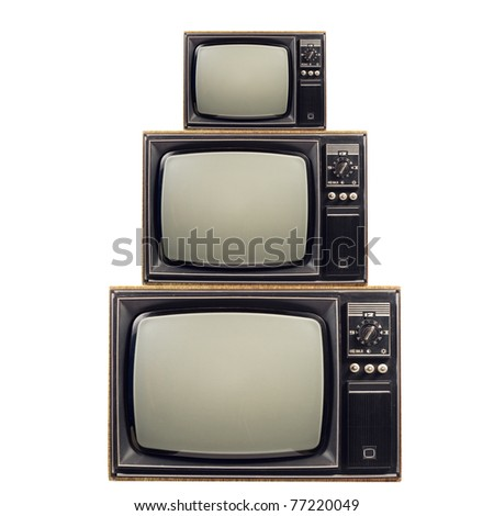 Pyramid of old TVs. - stock photo