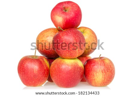 Pyramid of red apples isolated on white background - stock photo