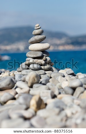 Pyramid of stones captured on a sunny day - stock photo