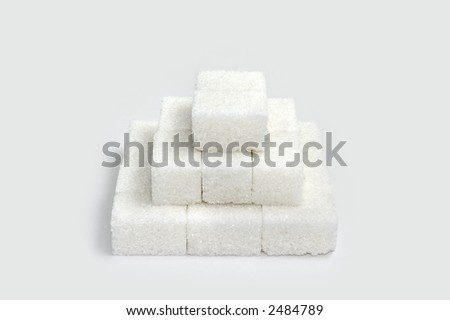 Pyramid of sugar blocks - stock photo
