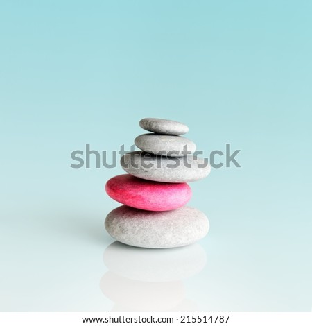 Pyramid of the stones isolated on a gradient background - stock photo