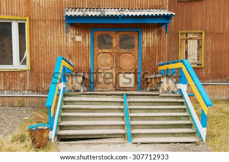 PYRAMIDEN, NORWAY - SEPTEMBER 03, 2011: Exterior of the deserted building entrance at the abandoned Russian arctic settlement Pyramiden, Norway. - stock photo