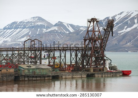 PYRAMIDEN, NORWAY - SEPTEMBER 03, 2011: View to the pier of the abandoned Russian arctic settlement Pyramiden, Norway. - stock photo
