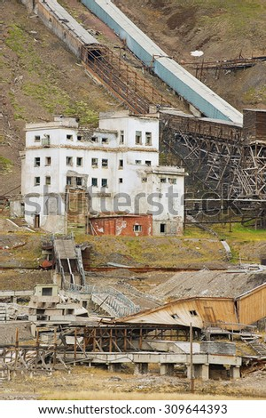 PYRAMIDEN, NORWAY - SEPTEMBER 03, 2011: View to the ruined coal mine in the abandoned Russian arctic settlement Pyramiden, Norway. - stock photo