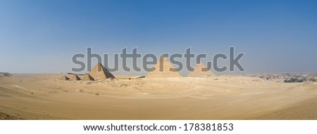 Pyramids of Menkaure, of Khafre and of Khufu Cheops, near Giza, Cairo.  - stock photo