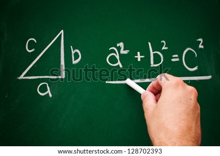 Pythagorean theorem sketched with white chalk on a chalk board - stock photo