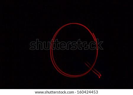 Q - torch light alphabet letters - stock photo