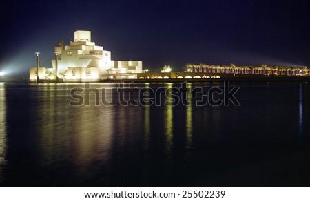 Qatar's Islamic heritage museum, on Doha Corniche, seen at night, February 2009 - stock photo
