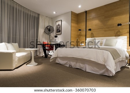 QINGDAO, CHINA - JULY 30, 2015: Interior view of a luxury modern chinese hotel bedroom in Qingdao, China, on Jul 30, 2015 - stock photo