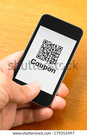 QR code coupon on mobile - stock photo