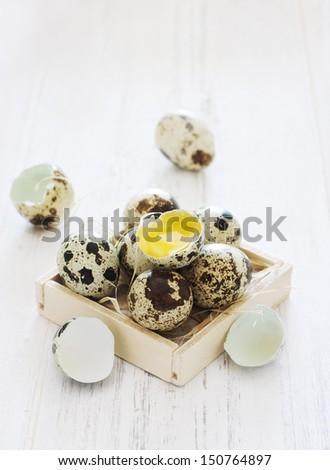 Quail eggs in a wood box - stock photo