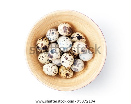 Quail eggs in bowl. With clipping path. - stock photo