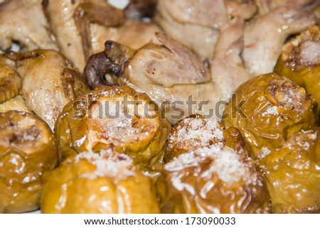 quail on apples with honey and nuts - stock photo