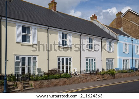 Quaint terrace houses on the seafront in Hythe, kent, UK - stock photo