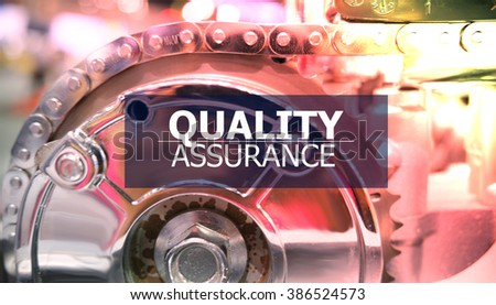 QUALITY ASSURANCE on the Mechanism of Metal Cogwheels background , color filter image , innovation concept , business concept, business idea - stock photo