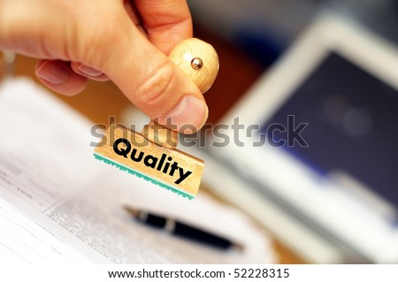 quality concept with stamp in business office and copyspace - stock photo