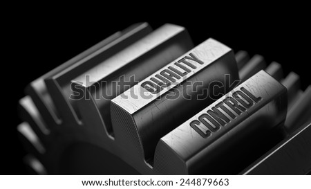 Quality Control on the Metal Gears on Black Background.  - stock photo