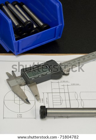 quality control process, checking part against CAD drawing - stock photo