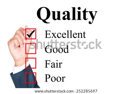 Quality evaluation form tick excellent by businessman - stock photo