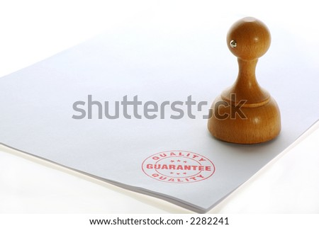 Quality rubber stamp - stock photo