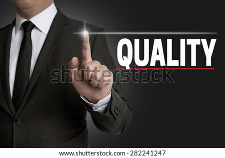 Quality touchscreen is operated by businessman. - stock photo