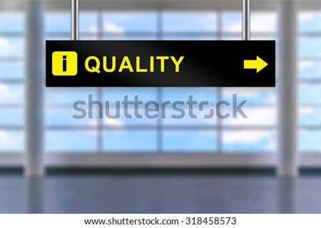 quality word on airport sign board with blurred background - stock photo